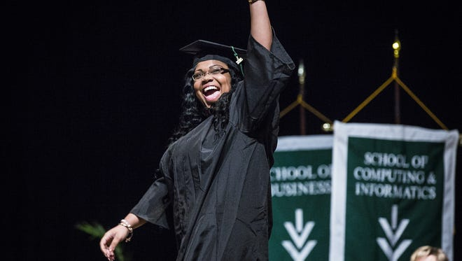 A student celebrates during the Ivy Tech 2016 graduation ceremony in Muncie earlier this year.