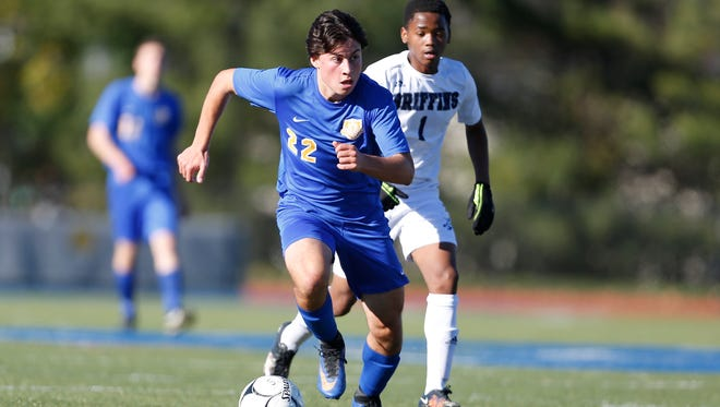 North Salem's Michael Bossi (22) controls the ball at mid-field during their 2-1 overtime win over World of Inquiry to claim the NYSPHSAA Class C boys state soccer championship title at Middletown High School on Sunday, November 13, 2016.