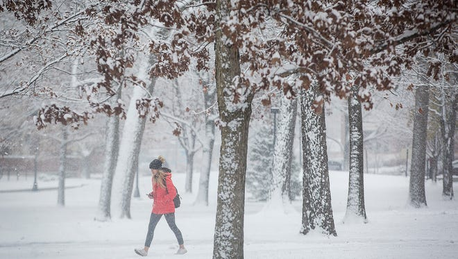 A student walks to class at Ball State Tuesday morning.