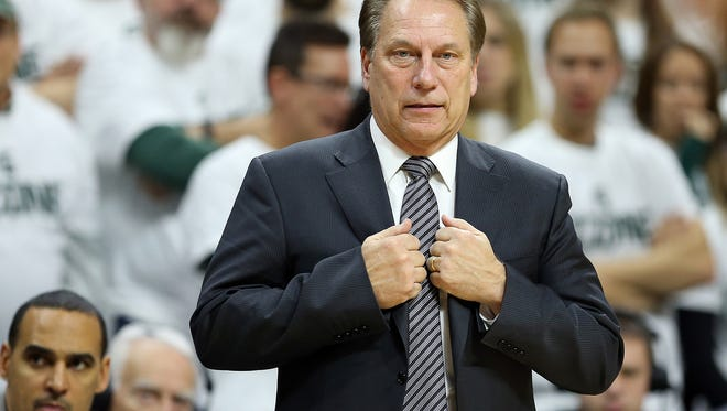 Michigan State coach Tom Izzo stands on the court during the second half of MSU's 61-52 win over Northwestern Friday at Breslin Center.