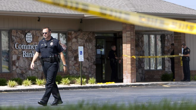 Springfield police on the scene of a bank robbery on West Republic Road in 2010.