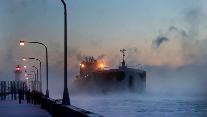 Steam rises from Lake Superior as the ship St. Clair comes to harbor during some of the coldest temps of the year, Sunday, Dec. 31, 2017, at Canal Park in Duluth, MN.