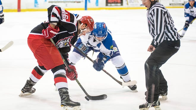 Port Huron Prowlers player Austin Daae (16) faces off against the Watertown Wolves' Matt Caranci during the first game of the Commissioner's Cup playoffs at McMorran Arena Friday, April 20.