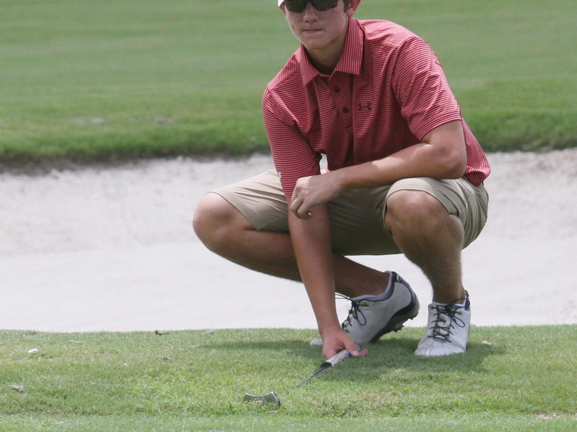 ECS golfer Shane Reynolds line up a putt on the 2nd hole while practicing at the Verandah Golf Club on Saturday.