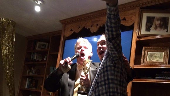 Stu Whitney (left) and Cory Myers announce Myers' victory at last year's Oscar Extravaganza.