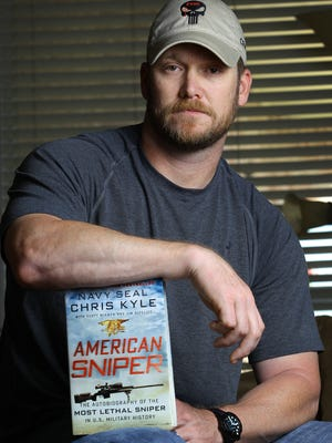 """The late Chris Kyle, a former Navy SEAL and author of the book """"American Sniper,"""" poses in Midlothian, Texas, in 2013."""
