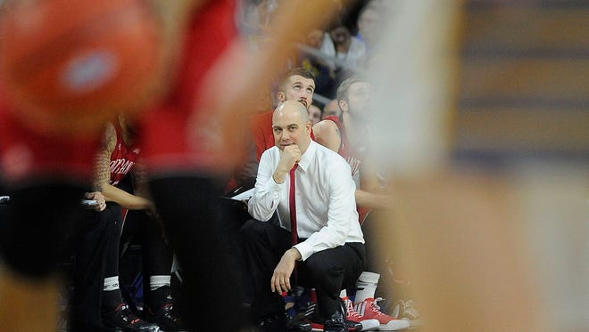 USD's head coach Craig Smith watches as his team plays SDSU during the Summit League Tournament in March.