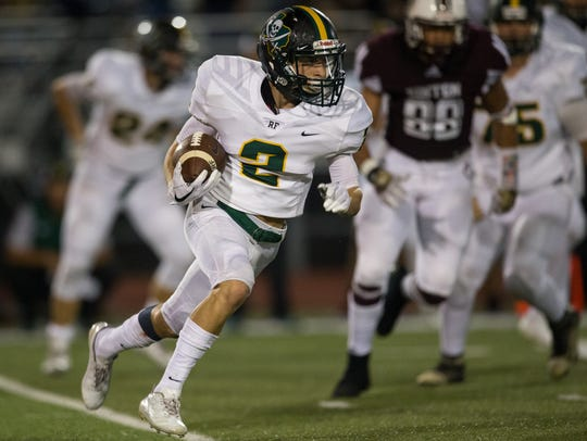 Rockport-Fulton's Chase Rios runs the ball during the