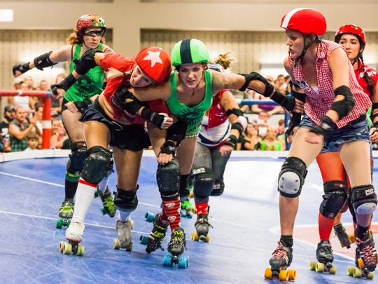 "The Cherry Bombs battle the Rhinestone Cowgirls, Austin, Texas, 2011. This photo is part of the new exhibit ""Hometown Teams: Sports in American Communities"" at the Alliance for the Arts in Fort Myers."