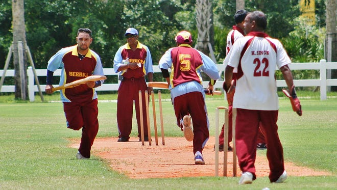 Berbice players score runs during the match.
