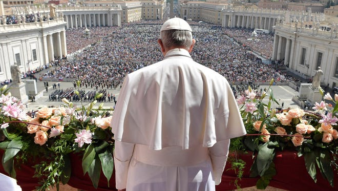 Pope Francis addresses the crowd prior to delivering his Urbi et Orbi (to the city and to the world) message from the main balcony of St. Peter's Basilica, at the Vatican, on Sunday, April 16, 2017.