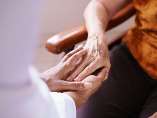 Doctor Visiting Senior Woman