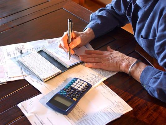 636308796573684766-paying-bills.jpg