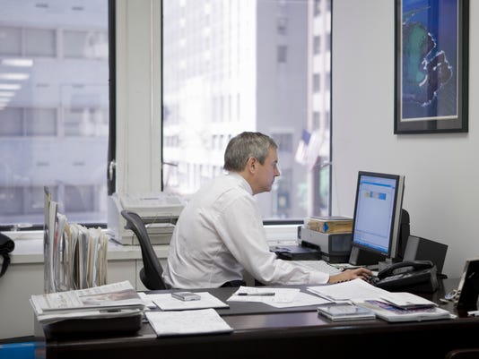 Man in office sitting at computer