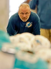 Miami Dolphins defensive coordinator Kevin Coyle watches the players during NFL football practice Wednesday, Oct. 7, 2015, in Davie, Fla. (AP Photo/Alan Diaz)
