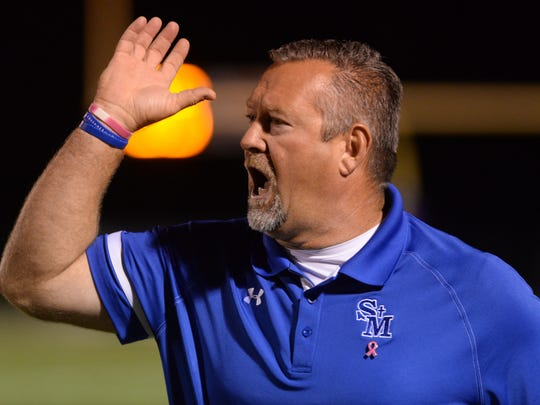 St. Mary's head coach Lee Doty yells to his team from the sidelines during his game against Logansport October 24, 2014.