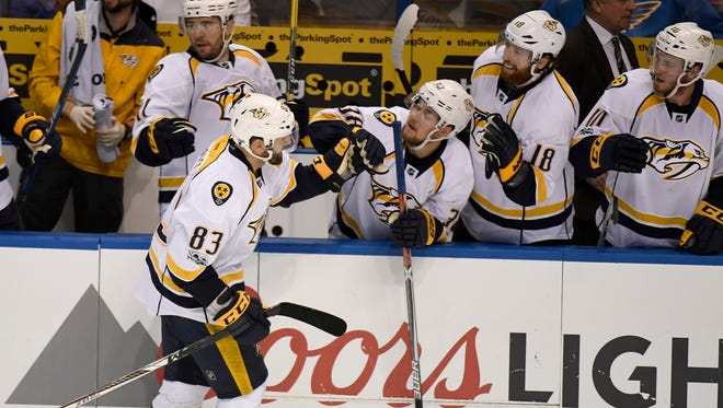 Predators center Vernon Fiddler (83) is congratulated by his teammate for his goal during the third period in game 1 of the second round NHL Stanley Cup Playoffs at the Scottrade Center Wednesday, April 26, 2017, in St. Louis, Mo.