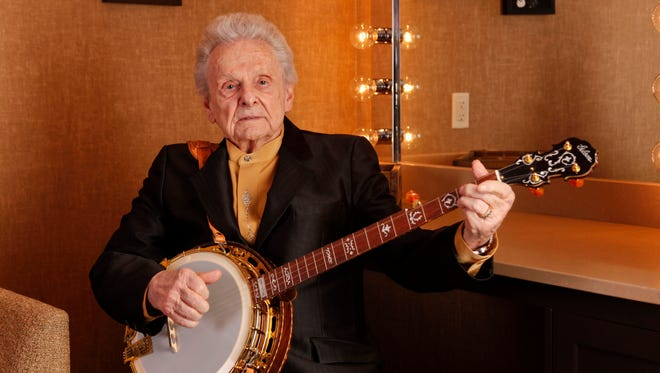 Ralph Stanley poses for a photo backstage in 2011 at the Grand Ole Opry House in Nashville, Tenn.