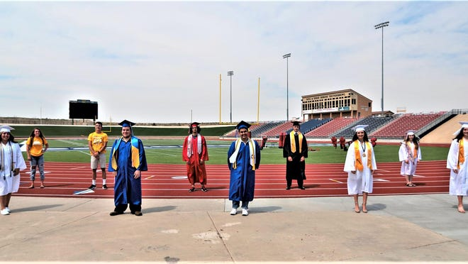Students representing the four Pueblo School District 60 schools stand on the track of the Neta and Eddie DeRose Thunderbowl, where in-person graduation ceremonies are slated to take place in late July.