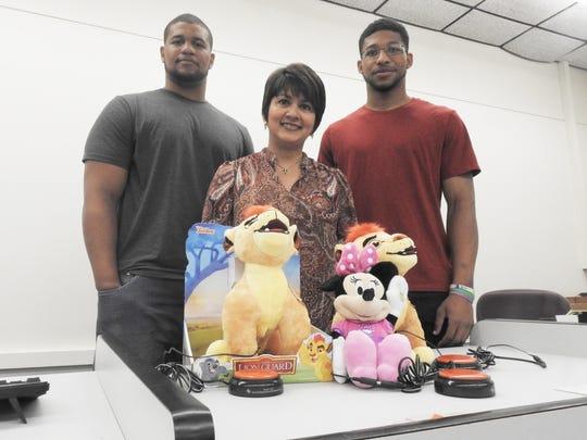 Staci Wilson, left,  Associate Professor of Engineering Dr. Sandra Soto-Caban and Warren Wilson implemented the toy adaption program at Muskingum University this summer.