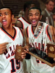Malone basketball players celebrate winning the 1995 Class 1A state title.