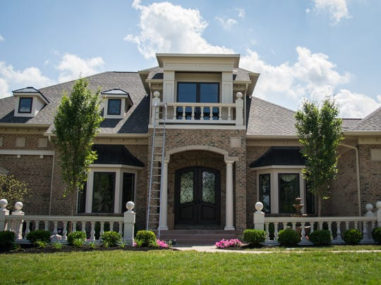 House five, Villa Maribella by Ohio builder Justin Doyle, combines old world elegance in its decor and architectual style with a modern twist. Photo taken July 10, 2014. The Enquirer / Madison Schmidt