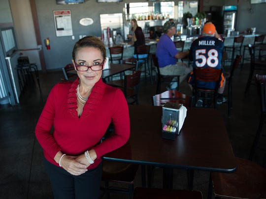 Marci Dickerson, owner of the Game, Game II and Dickerson Catering stands in the second floor bar of the Game II. Monday September 11, 2017