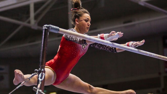 Southern Utah's Danielle Ramirez competes on the bars during the meet against Michigan and UC Davis, Friday, Feb. 19, 2016.