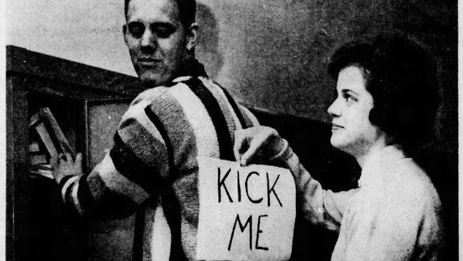 """The classic """"kick me"""" sign never gets old."""