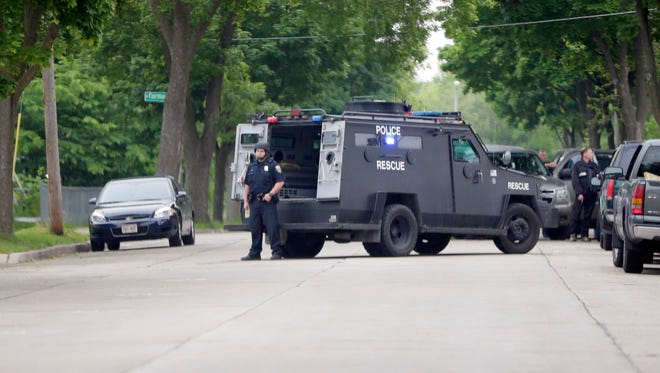 A Milwaukee police tactical vehicle is stationed outside a home on N. 27th St. during a raid by the FBI-MPD Gang Task Force in the summer of 2015.