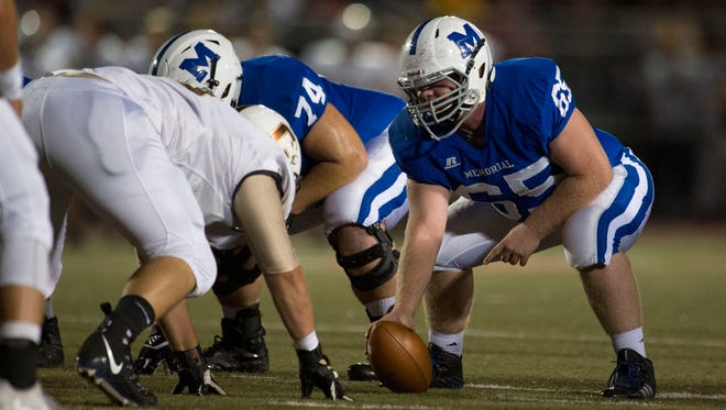 Memorial's Jake Barnett (65) prepares to snap the ball as Memorial takes on the Central Bears at Enlow Field in Evansville, Ind., on Friday, Sept. 29, 2017. Central won 35-7.