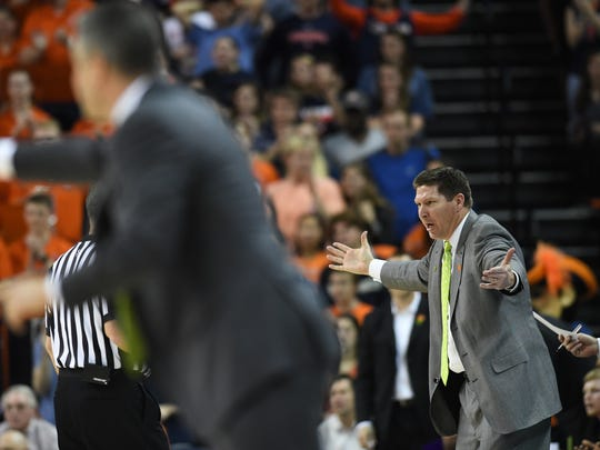 Clemson head coach Brad Brownell coaches against Virginia during the 1st half on Tuesday, January 23, 2018, at UVA's John Paul Jones Arena in Charlottesville, Va.