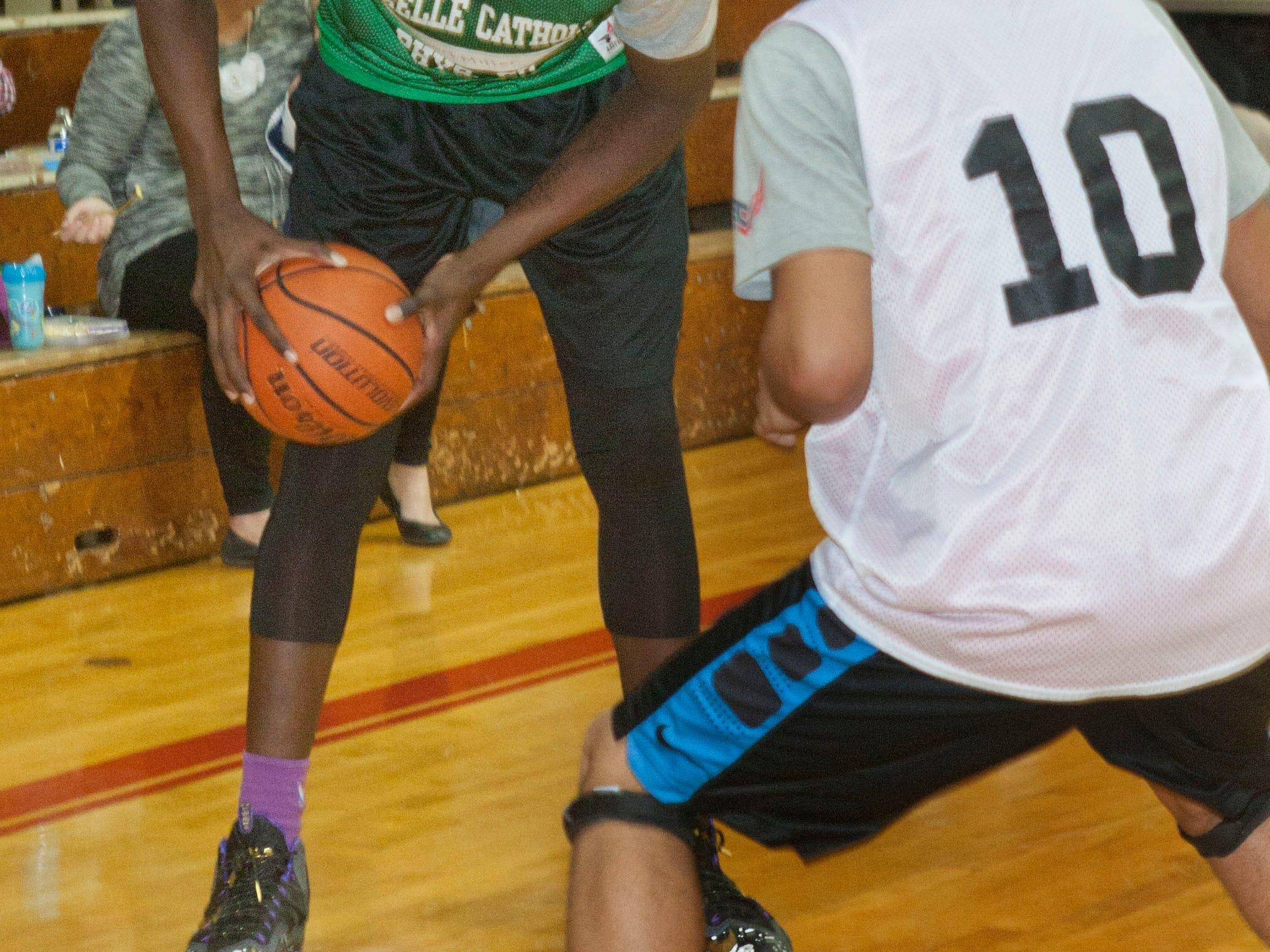 Nazreon Reid, a freshman at Roselle Catholic HS from Asbury Park, in a basketball scrimmage at Pt. Pleasant Beach HS - December 15, 2014-Pt. Pleasant, NJ.-Staff photographer/Bob Bielk/Asbury Park Press