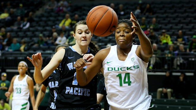 Oregon forward Jillian Alleyne (14) goes after a rebound against Warner Pacific during an exhibition game inside Matthew Knight Arena, Wednesday, November 11, 2015, at the University of Oregon in Eugene, Ore. Oregon won the game 99-46.