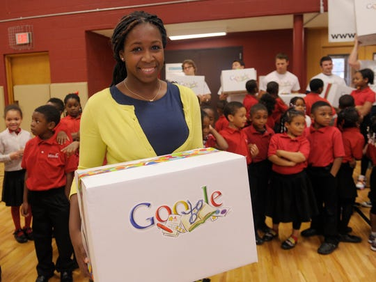 Alexis Jackson, 24, a first grade teacher ,holds her box of supplies from Google on Tuesday.