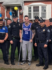 Camden County police officers welcomed Patrick O'Hanlon home after his release from a hospital Saturday.