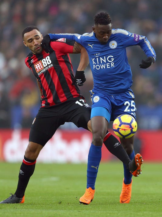 AFC Bournemouth's Callum Wilson, left, and Leicester City's Wilfred Ndidi in action during the English Premier League soccer match at the King Power Stadium in Leicester, England, Saturday March 3, 2018. (Tim Goode/PA via AP)