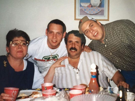 Police say Daniel Garofalo, 41 (second from left, in an older photo), was shot and killed by 21-year-old Zachary Penton during a confrontation inside the home. David Garofalo is pictured at the far right in the photo.