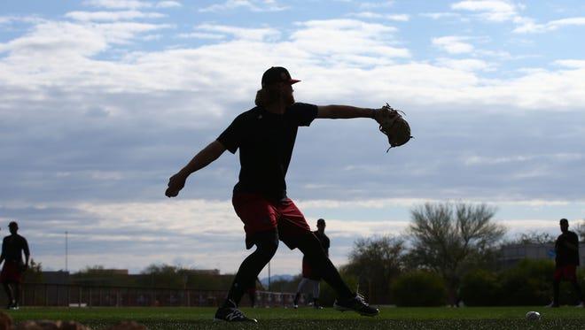 Arizona Diamondbacks pitcher Matt Koch tosses the ball around as pitchers and catchers report to spring training camp on Feb. 13, 2017 at Salt River Fields in Scottsdale, Ariz.