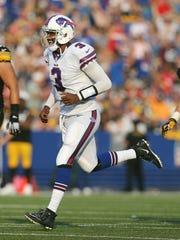 Bills QB EJ Manuel is all smiles as he runs to congratulate receiver Tobias Palmer who caught a 37-yard touchdown pass.