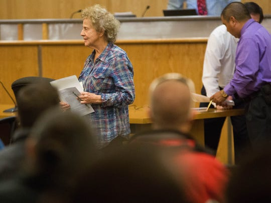 Susan Krueger, past president of the Doña Ana County Historical Society, gave brief comments on the Old Picacho Cemetery, essentially asking others at the auction to allow the Historical Society to win the bidding for that property. Friday Dec 15, 2017 at the Doña Ana County Government Center, during the Doña Ana County Property Tax Auction.