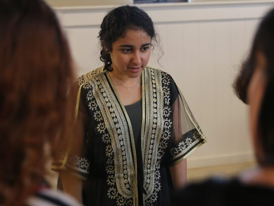 Amirah Alghadhouri, from Kuwait, fields questions on