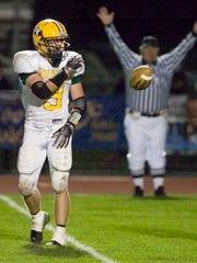 Howell's Bryce Lindberg flips the ball to an official