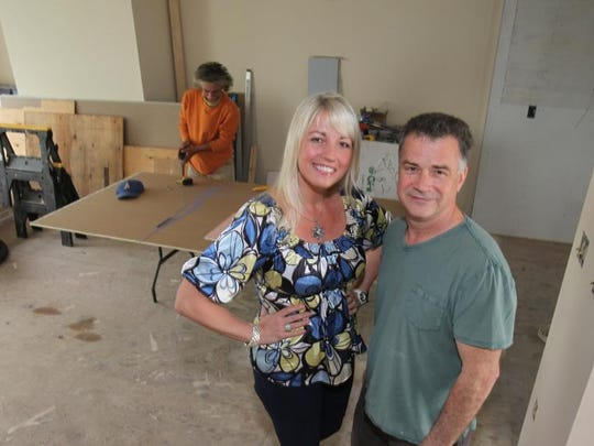 Walter and Luba Sydor stand May 23, 2014 in the townhouse they are renovating as they prepare to flip the property. In the back is general contractor Adrian Wowk.
