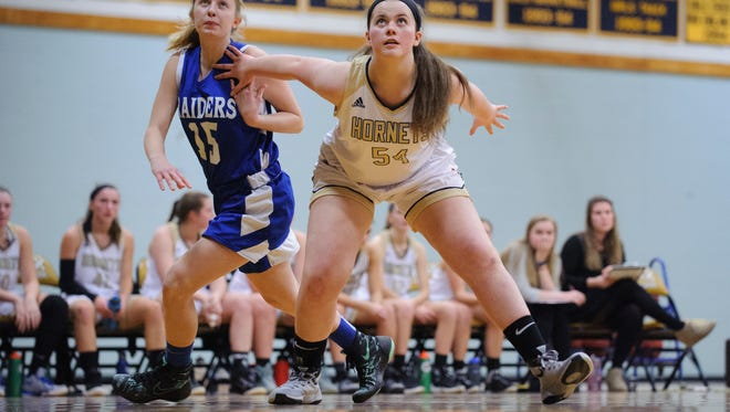 Essex's Madeline Folsom (54) blocks out U-32's Zoie Beauregard (15) during a free throw attempt in the girls basketball game between the U-32 Raiders and the Essex Hornets at Essex High School on Wednesday night December 27, 2017 in Essex.