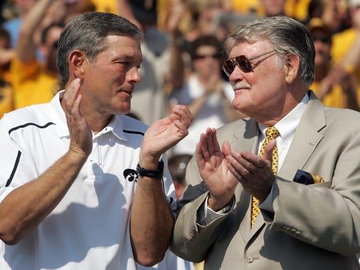 Iowa head coach Kirk Ferentz applauds with former Iowa