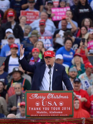 President -elect Donald Trump speaks to the crowd Saturday during the last leg of his USA Thank You Tour 2016 at Ladd-Peebles Stadium in Mobile, Alabama.