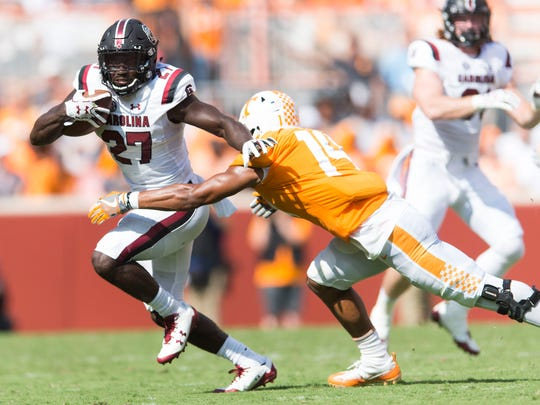 Tennessee linebacker Quart'e Sapp (14) takes down South Carolina running back Ty'Son Williams (27) during a Tennessee vs. South Carolina game at Neyland Stadium in Knoxville, Tenn. Saturday, Oct. 14, 2017.