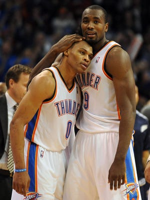 Thunder guard Russell Westbrook is hugged by teammate Serge Ibaka after a game-winning three-pointer against the Warriors on Nov. 29.