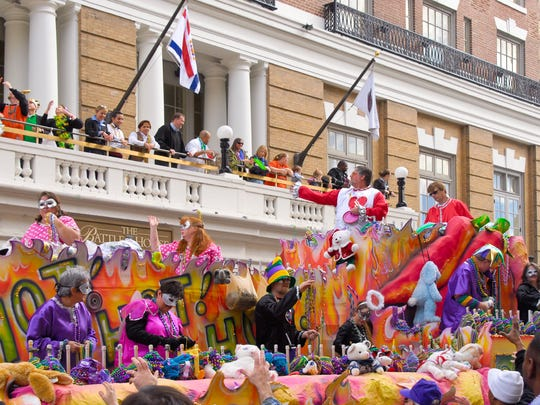 A Mardi Gras parade passes in front of The Battlehouse